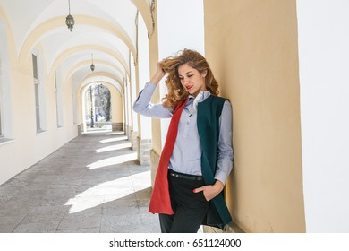 Beautiful sexy blonde business walking and posing on the Sunny city