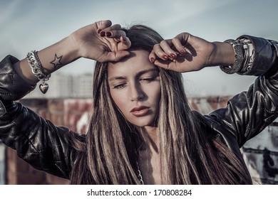 beautiful sexy blonde fashion woman posing on roof