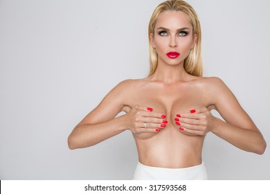 beautiful sexy blonde female model standing naked with big breasts veiled cower married with a ring on her finger on a white background erotic makeup voluptuous red lips