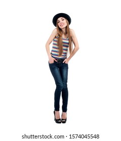 Beautiful sexy blonde girl in blue jeans T-shirt and hat posing on white background isolated