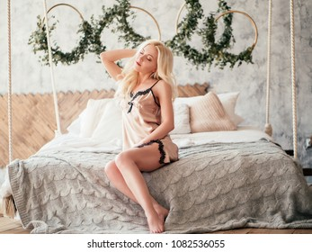 Beautiful sexy blonde girl posing in the morning in the hotel's interior