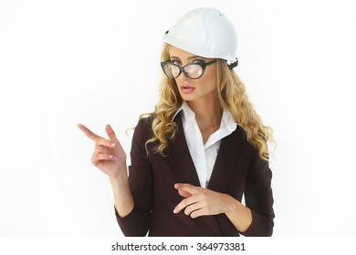 Beautiful sexy blonde in a white hard hat and a dark brown suit on white background. Architect, Manager, Auditor