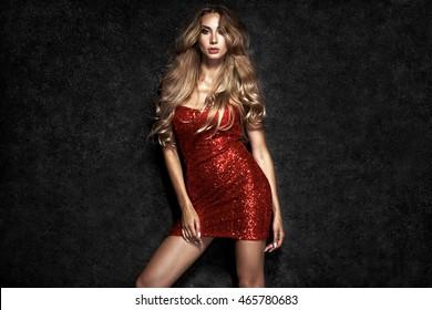 Beautiful sexy blonde woman on black background
