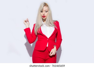 Beautiful sexy blonde woman wear red cotton costume jacket and pants autumn-spring collection clothes for business lady casual work office style make poses fashion model