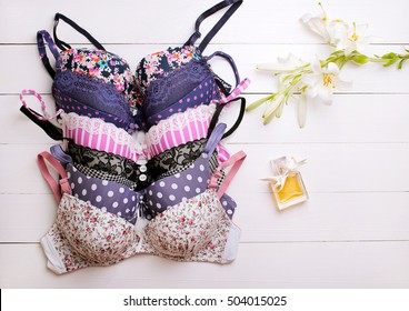 beautiful sexy bras on a wooden background