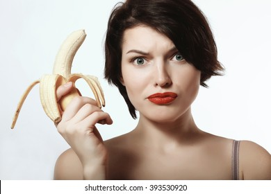 beautiful and sexy brunette with a banana in his hand
