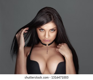 Beautiful sexy brunette in black underwear with big breasts and beautiful eyes.