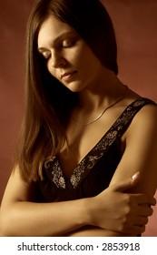 Beautiful sexy brunette girl, dressed in a little black dress