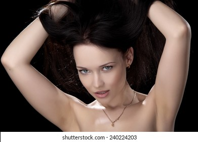 Beautiful sexy brunette girl posing on a black background