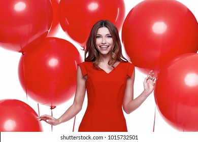 Beautiful sexy brunette woman skinny business style dress diplomatic red color perfect body shape busy glamour lady casual style hostess etiquette balloon party celebrate birthday romantic surprise.
