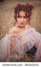 beautiful sexy caucasian woman on meadow