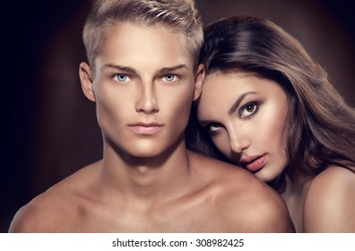 Beautiful sexy couple portrait. Model man with his girlfriend posing together. Passion. Boy and Girl in love