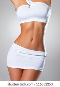 Beautiful sexy female slim tanned body - a studio shot