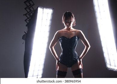 beautiful sexy girl in a corset in a photo studio