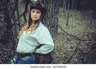 beautiful sexy girl in a cowboy hat