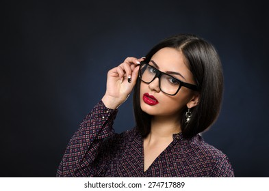 Beautiful and sexy girl with glasses and red lips