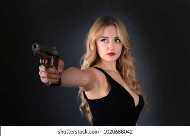 Beautiful sexy girl with gun