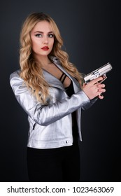 Beautiful sexy girl with gun