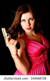 Beautiful sexy girl with gun isolated on black background