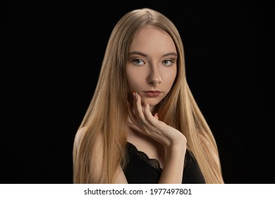 Beautiful sexy girl, has long shiny hair, big gray eyes, dressed in black shirt. Studio portrait isolated. Nature romantic pure makeup. Summer fashion style. Beauty pure skin.