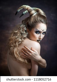 Beautiful sexy girl in the image of the zodiac signs of Capricorn