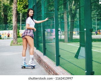 beautiful sexy girl with long legs wis a skateboard