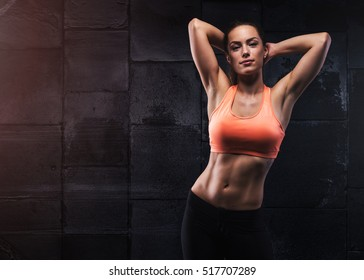Beautiful sexy girl with muscular body posing. Fitness concept.