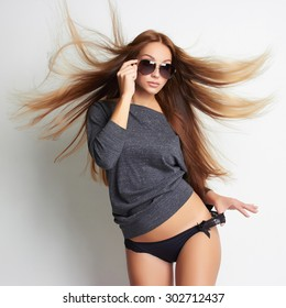 beautiful sexy girl in underwear and sunglasses. beauty woman. flying healthy hair