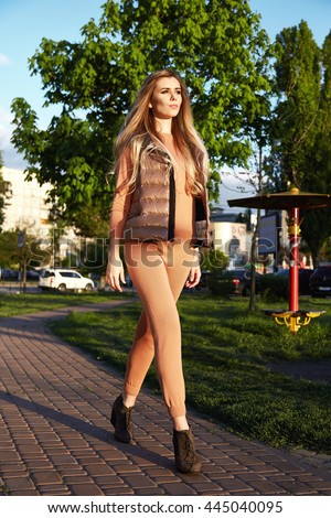 d86c229e3 Beautiful sexy girl walk in park garden summer autumn weather sun shine  wear kitten merino wool