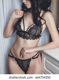 Beautiful sexy girl wearing lace lingerie handmade