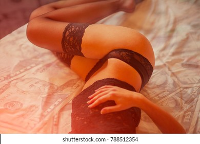 Beautiful sexy lady in elegant black panties and stockings. Prostitution and escort concept - woman prostitute or stripper on bed with banknotes on background. romantic evening