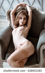 Beautiful sexy lady in elegant pink panties and stockings. Fashion portrait of model indoors. Beauty brunette woman with attractive body in lace lingerie. Female ass in underwear. Close up naked girl