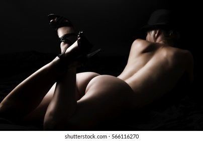 beautiful sexy naked woman lying on the ground. she only wears a hat.