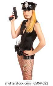 Beautiful sexy police girl with handgun and handcuffs, isolated on white background