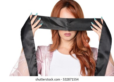 Beautiful sexy redhead woman with black lace on the eyes blindfolded games sexy. Isolated