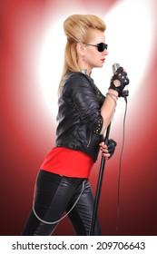 Beautiful sexy rocker girl singing expressive