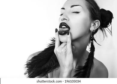 Beautiful sexy stylish woman stick her tongue out, black-and-white photo (Cheeky youth)