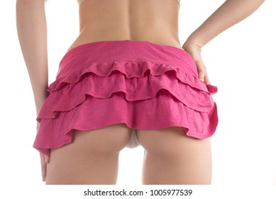 Beautiful sexy tightened ass of a young woman in white and pink underwear and in a short skirt.