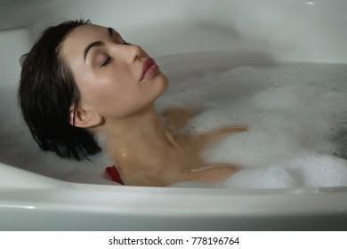 Beautiful sexy woman in a  bathroom. Spa body care.