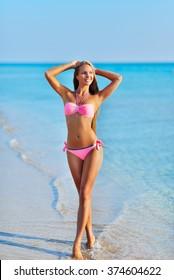 the beautiful sexy woman in bikini resting on a beach