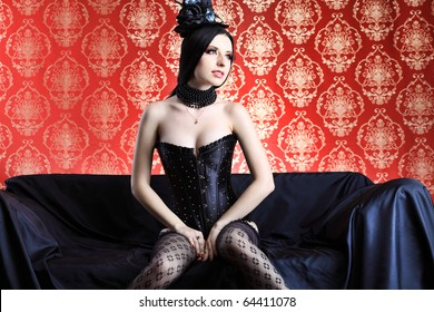 Beautiful sexy woman in black lingerie over vintage background.