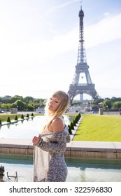 Beautiful sexy woman with blond hair in Paris at the Eiffel Tower