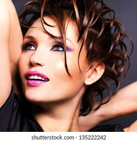 Beautiful sexy woman with bright pink makeup and stylish fashion hairstyle - posing at studio.