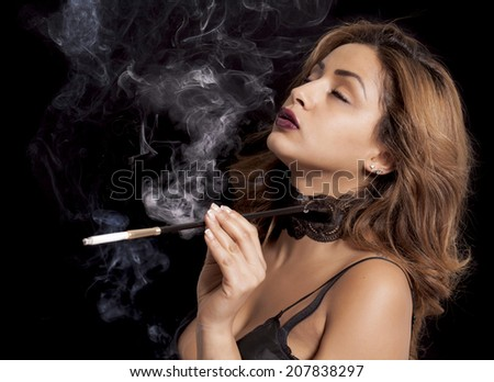 Sexy women smoking with holders