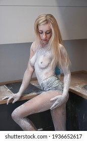 Beautiful sexy woman cook in the kitchen covered in flour. Nude girl in sexy erotic positions.