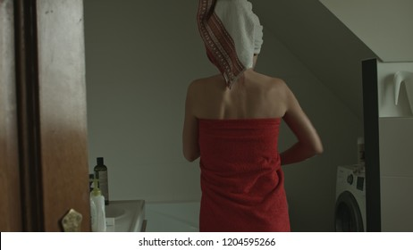 Beautiful sexy woman covering her body with towel after bath. Beauty and skin care concept