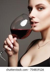 Beautiful sexy woman drinking red wine.beauty girl with wineglass