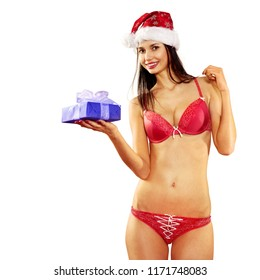 Beautiful and sexy woman with gift box wearing santa clause costume on white background