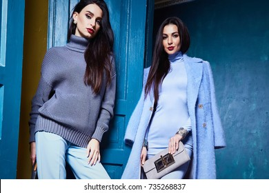 Beautiful sexy woman lady wear casual style outerwear wool cashmere coat trench blue color pretty face dark natural hair spring autumn collection glamour model fashion clothes interiors door.