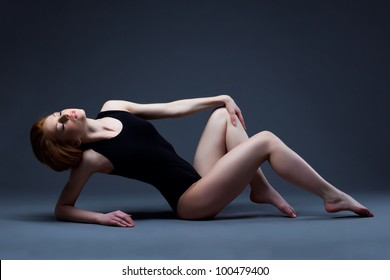 Beautiful sexy woman lay in sport suit